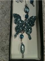 Closeup of Karen's butterfly necklace